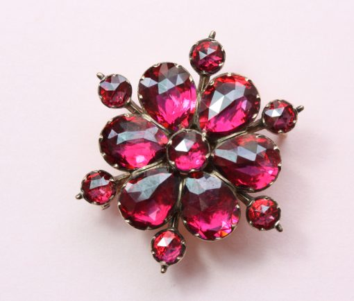 garnet and gold flower brooch