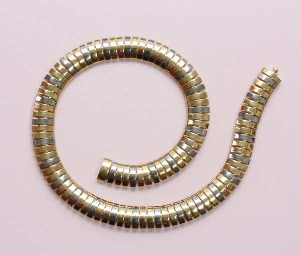 three colored gold bracelet and necklace