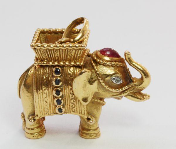 gold and gemset elephant pendant