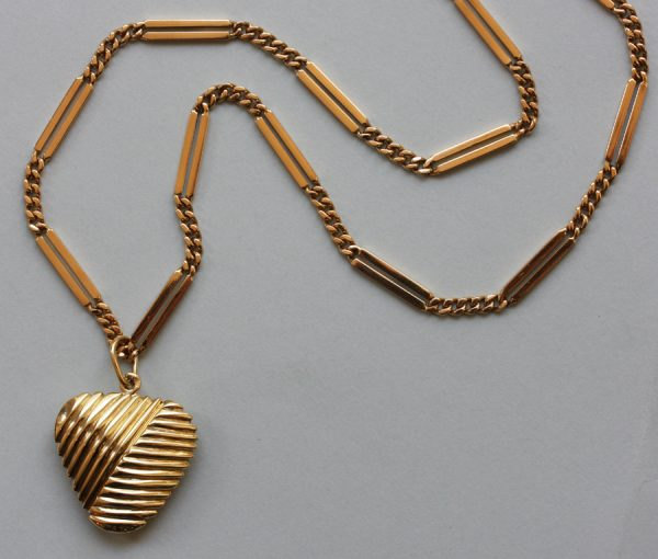 gold chain and heart pendant