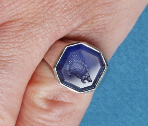 platinum and sapphire ring with an intaglio of a porcupine