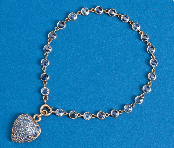 sapphire bracelet and heart shaped locket
