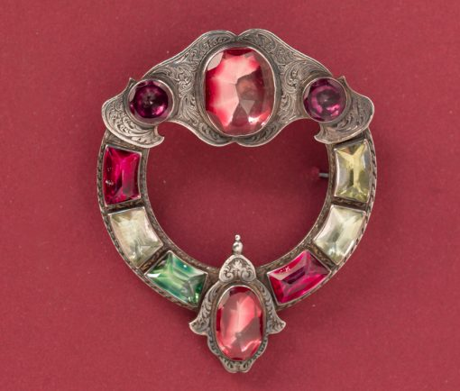 silver Scottish brooch with colored foiled rock crystal