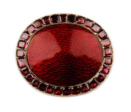 a red brooch