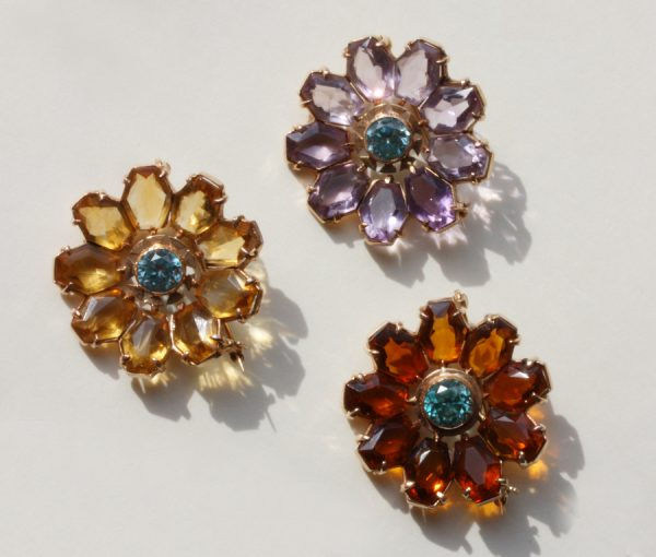 three flower brooches