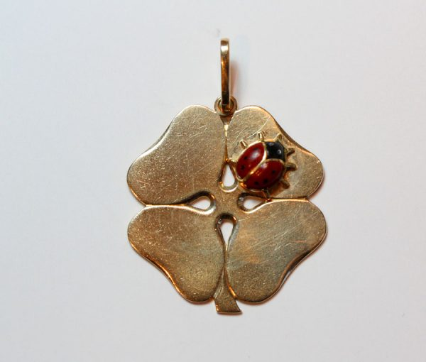 gold clover with a ladybird