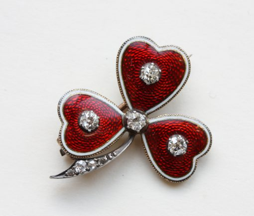 red enamel and diamond cloaver brooch