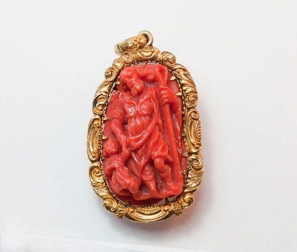 coral double cameo pendant