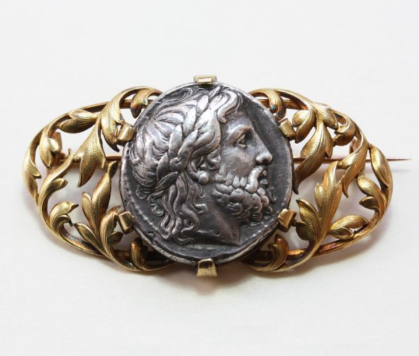 gold and silver coin brooch