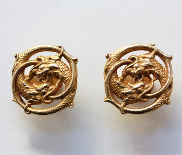 gold cufflinks with sea creatures