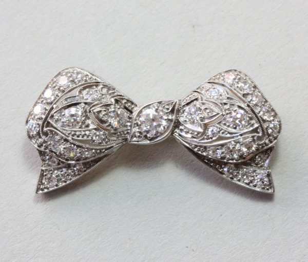 platinum and diamond bow brooch