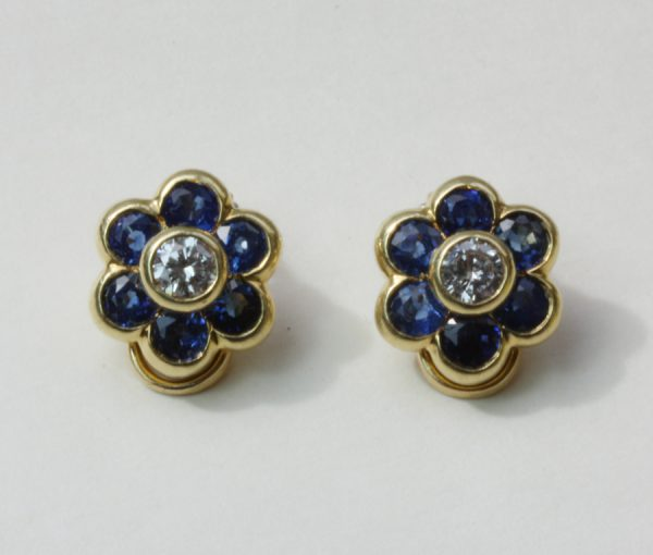 diamond and sapphire flower ear clips