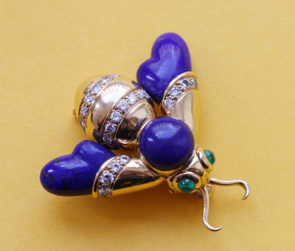 gold and lapis bee brooch