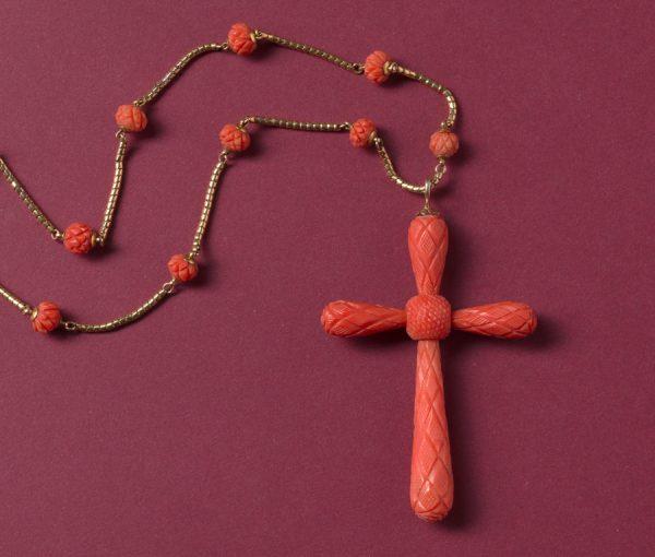 coral cross pendant
