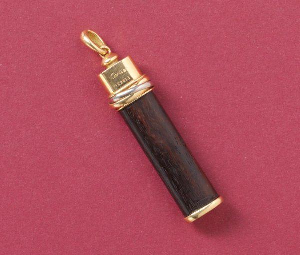 cartier wooden pendant