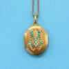 gold locket with turquoise