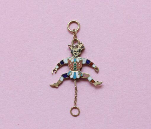 gold mechanical harlequin charm