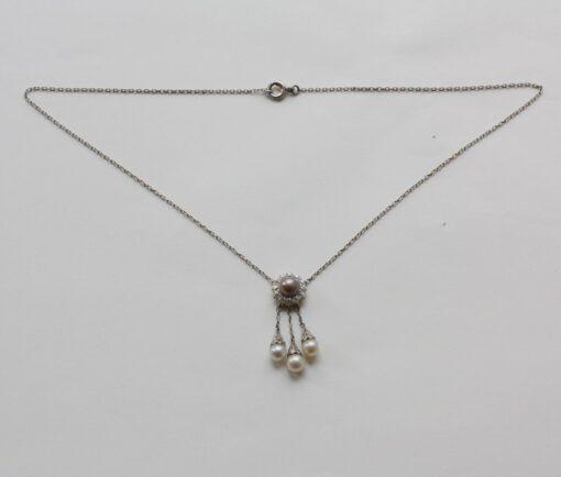 Tiffany platinum diamond and pearl pendant