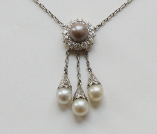 Tiffany platinum diamond and pearl pendant