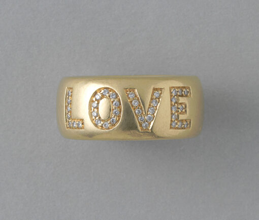 gold and diamond love ring
