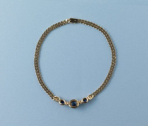 gold gourmette chain with diamond and sapphire